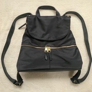Steve Madden black purse backpack